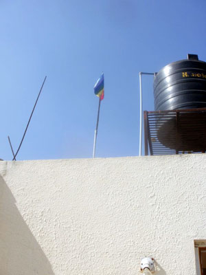 Meher Baba's flag flies from Sky and Njeri Wiseman's home in Arangaon village, near Meherabad.